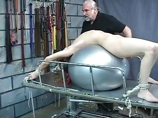 Sexy sub gets her round ass smacked until it turns red