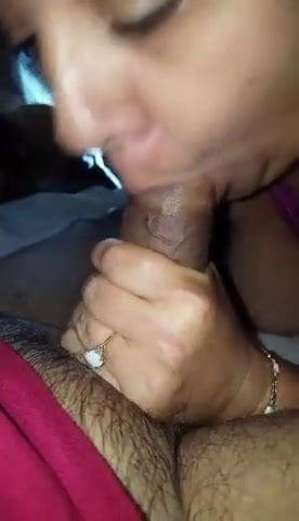 Haggard looking milf sucking a black cock
