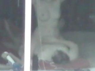 Voyeur window sex of couple