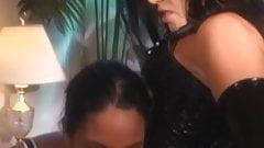 Busty latex vixen dominates young dark skinned babe
