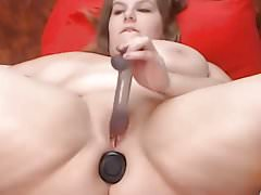 Fat girl having fun with toys Thumbnail