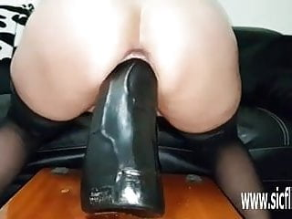 Colossal dildos stretch her insatiable loose pussy