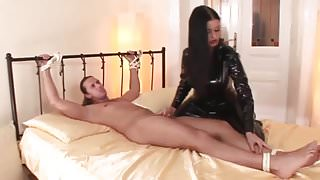 Slut Sucks Sub In Black Latex Cat Suit And Tit Cumshot