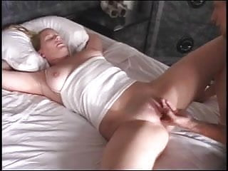 Curvy blonde spreads legs on bed and gets her pussy eaten
