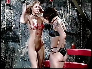 Lesbo slut covered in wax and dildo fucked
