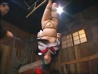 Breast Flogging an Upside-down Japanese JK to Orgasm