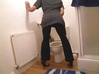 Chambermaid in her bathroom wearing high heels very horny