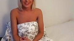 Blonde masturbates on bed POV