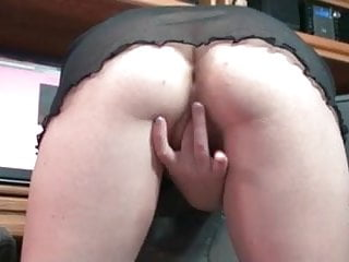 redhead with glasses rubs her pussy