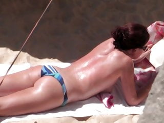 sunbathing topless and which magnificent bottom
