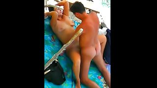 Tanned husband and wife fucked vigorously on the beach