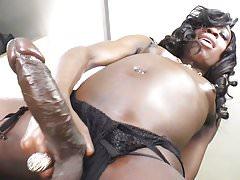 Black trans-girl jerking her monster cock