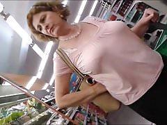 Beautiful mature lady's tits at the market