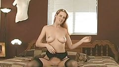 Horny blonde strips and masturbates in her bed