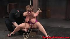 Bonded busty submissive humiliated at the dungeon