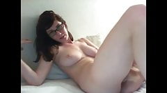 hot brunette nerd takes on large dildo and cums