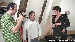 Hairy granma in red lingerie swallows two dicks
