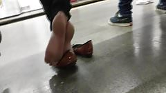 Candid blonde red toenails Feet in flats in subway