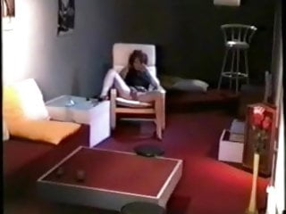 My mom home alone fingering in living room. Hidden cam