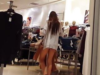 Candid voyeur long leg teen shopping in tiny shorts