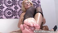 Feet worshiped babe gives footjob while fingered in pussy