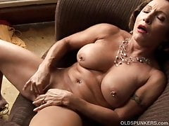 Tasty old spunker with a tight body plays with her wet pussy