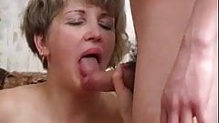 Older lady takes two younger cocks