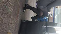 Flight attendant in heels and pantyhose