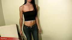 Brunette ladyboy strips off jeans and plays with dick head
