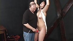 Dark?haired hottie, bound and has her pussy pleasured by her master