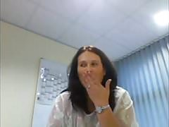 Webcam secretary flashes her heavy hangers in the office