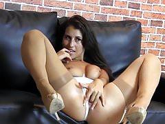 Hot brunette pussy tease in white lingerie nylon stockings