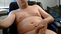 Smooth daddy with nice curved uncut cock