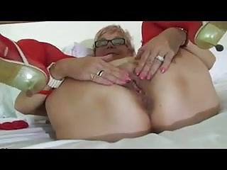 Sexy Granny In Red Lingerie Masturbates In Bed