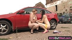 Girls Out West - Busty lesbians at the car park