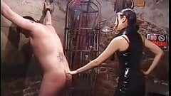 Cute asian dominatrix whips sex slave in bondage basement