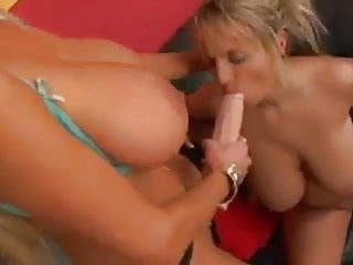 Busty girls use a big strapon cock for pleasure