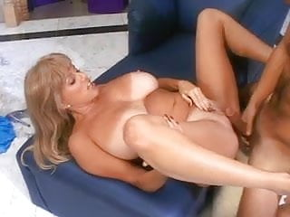 Mature huge tanned tits